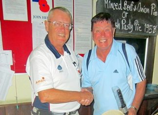 Dick Warberg (left) presents the MBMG golfer of the month award to John Hackett.