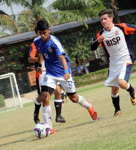 Regents take on British International School Phuket in the boys' football final.