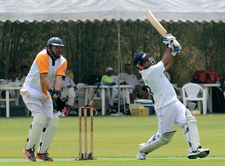 Indorama's Dhiraj (right) hits out on his way to a brilliant 102.
