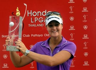 Sweden's Anna Nordqvist holds up the champion's trophy after winning the 2014 Honda LPGA Thailand tournament at Siam Country Club, Sunday, Feb. 23.