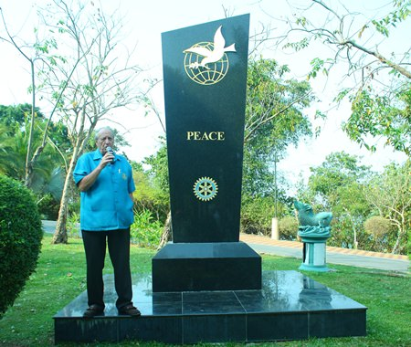 Past President Don Maclachlan narrates the history of the Rotary Peace Monument.