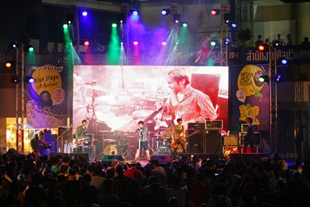 The Somkiat band from the Small Room label performs for fans on the blue stage at Central Festival Pattaya Beach.