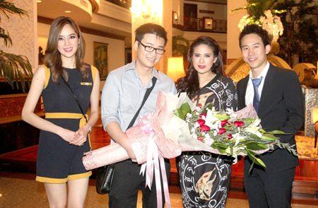 "(L to R) Amarapat Julkasian Vathanakul, Vathanai Vathanakul, and Vitanart Vathanakul, congratulate ""Tang Wong"" Executive Producer, Kanyarat Jirarachakij, with a bouquet of flowers for winning the Best Picture Award at the 23rd Subhanahongsa Awards."