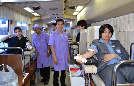 Employees at Pattaya's King Power duty-free mall donate blood inside Queen Savang Vadhana Memorial Hospital's 10-bed medically equipped bus.