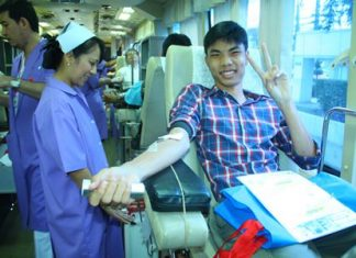 It only hurts for a minute, this smiling teenager says whilst donating blood.