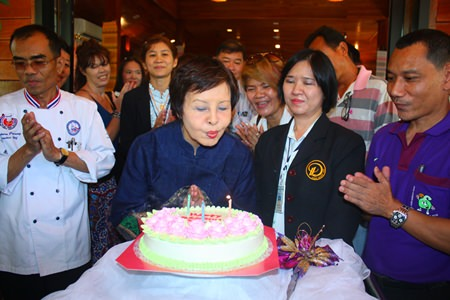 Sopin is cheered on by party guests as she blows out her birthday candles.