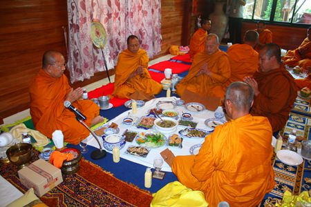 Diana Group staff offers lunch to the monks.