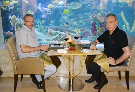 (L to R) Charly Geser and Peter Windgasse enjoy their wine at a great spot next to the aquarium inside the Oceana Lounge.