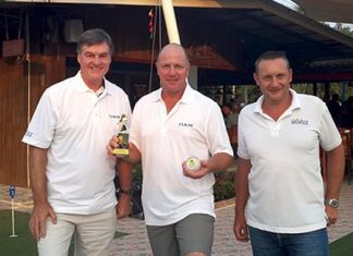 Pete Stonebridge (left) celebrates his hole in one with monthly medal winner Ian Heddle (center) and Geoff Hirst of DeVere.