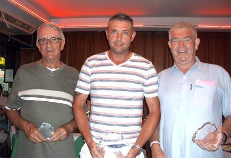 Plate winner Paul Shaw (center) with Bruce Walters and Reg McKay.