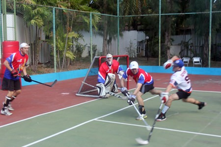 Thai Stix take on the Hong Kong Islanders in the final of the 20th Annual Mekong Cup ball hockey tournament at Centara Karon Resort in Phuket, Saturday, march 15.