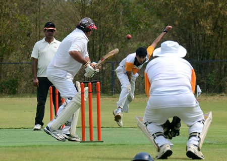 Hamza bowls to Stan during Siam C.C.'s run chase.