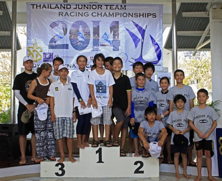 The top three teams representing Bangkok Patana School, Bangkok Prep and Regents International School Pattaya pose on the podium during the prize-giving ceremony.