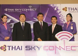 Chokchai Panyayong (center), THAI senior executive vice president of Commercial, and acting president, and Danuj Bunnag (second from left), THAI executive vice president, Products and Customer Services, launched THAI Sky Connect service that provides wireless internet connection (WiFi) on board flights operated with Airbus A330-300 and A380-800 aircraft in all classes of service. Dr. Settapong Malisuwan (second from right), vice chairman of the National Broadcasting and Telecommunications Commission (NBTC), joined the event at THAI's head office on Vibhavadi Rangsit Road.