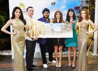 Apichart Gulati, Project Manager, Blue Sky Group Co., Ltd. (3rd left) presents gold prizes to lucky winners at the Sea of Prosperity party held at the Grande Caribbean Condo Resort Pattaya sales gallery on March 8.