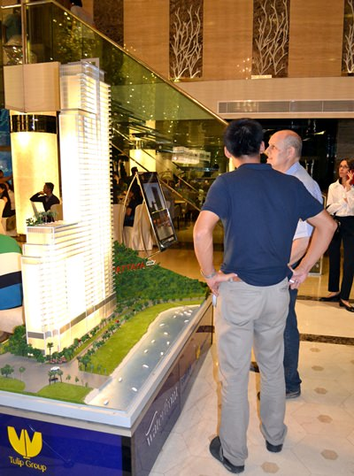 Party guests view a scale model of the project.