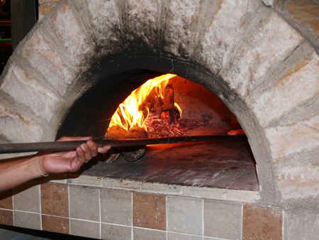 Andrea not only makes the pizzas, he also makes the pizza oven they are cooked in.
