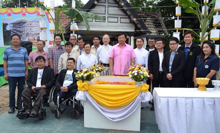 Local politicians and administrators of the Father Ray Foundation pose for a commemorative photo after the foundation stone placing ceremony.