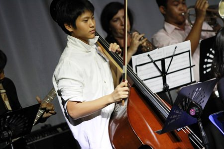 A Year 10 student helps out the band with his cello.