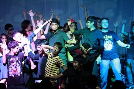 The choir perform 'Happy'.