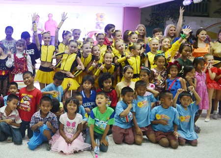 Children from Russia and Thailand, finding common ground in song and dance.