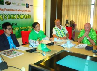 Father Ray Foundation President Rev. Michael Picharn Jaiseri (2nd left) announces that more than 850,000 baht was raised for charity from the St. Patrick's Day parade in Pattaya.
