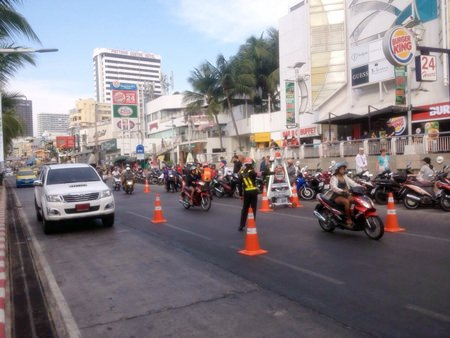 Police set up traffic check-points before Songkran in front of the Royal Garden Plaza.