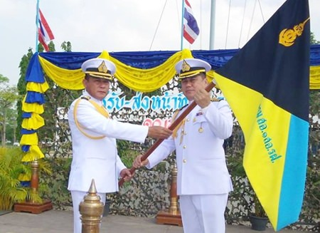 Capt. Sompong Phuwiang hands over the company flag to Capt. Somprasong Witladilokphan.