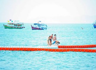 Currently, tourists are having fun walking on the buoys, but the city is putting larger gaps between the buoys to discourage their use as anything but a barrier to separate swimmers from boats and jet skis.
