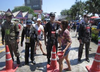 About 1,000 police officers and volunteers will slog through Pattaya April 19, just like these men, to provide security for the city's Songkran finale.