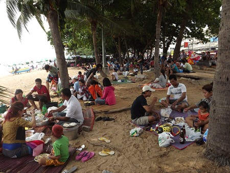 Many Bangkok denizens came to the city to celebrate, but instead of street food and restaurants, many brought their own cooking gear and ate on the beach.