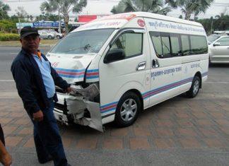 Van driver Pomuao Hadgadeang points to the damage on his van.