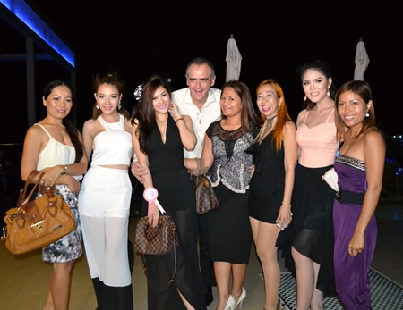 Leonard Stokes (center), Op. Director for A Farang Affair Co. Ltd., poses with the lovely ladies.