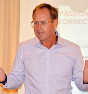 """Bruce Hancock, MD of the Banyan Resort, Hua Hin introduces, """"The Power of Passion""""."""