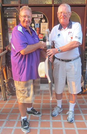 Dick Warberg (right) presents the MBMG Group Golfer of The Month award to Andre Van Dyk.
