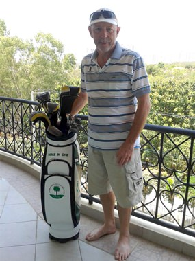 Bob Poole with his hole in one golf bag prize from the previous week.