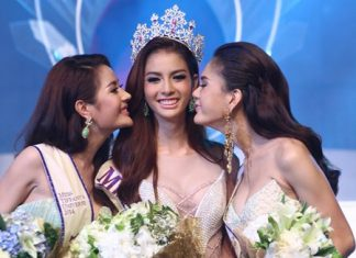 Miss Tiffany Universe 2014, Nissa Katerahong (centre) is congratulated by 1st and 2nd runners-up, Rachaya Noppakaroon and Trithipnipa Thippaphada.