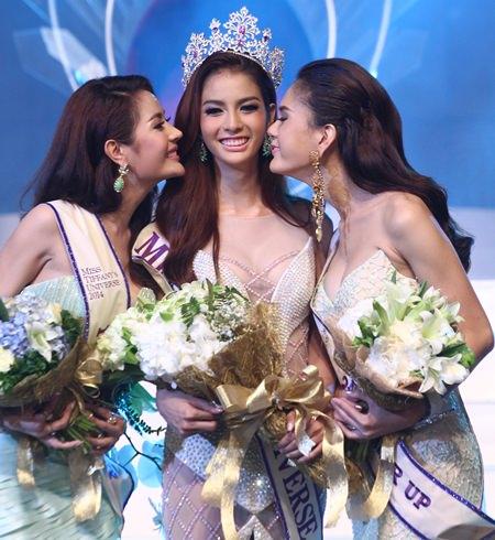 Miss Tiffany Universe 2014, Nissa Katerahong (centre) is congratulated by 1st and 2nd runners-up, Rachaya Noppakaroon and Trithipnipa Thippaphada.