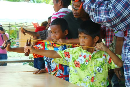 Ready, aim, fire!  Children enjoy testing their aim with the slingshots, an ancient local game.