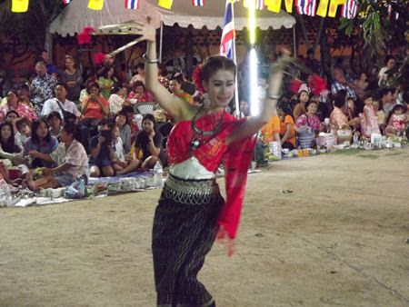 A woman performs the Peefah dance (traditional spiritual dance).