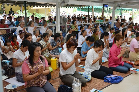 Citizens listen to sermons and receive blessings from monks.