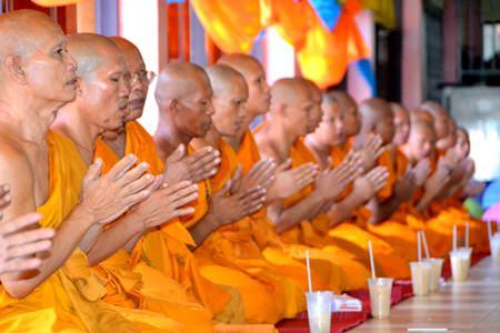 Monks pray before dining.