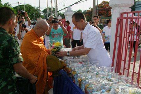 Chonburi Governor Khomsan Ekachai presents alms to monks on Visakha Bucha Day at Chonburi Provincial Hall.