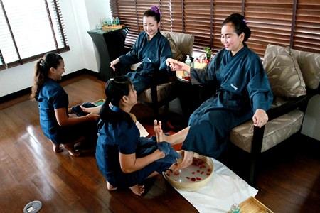 Attentive spa staff prepare guests for a treatment.