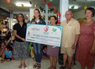 PILC members and friends hand over 62,000 baht to the Hand to Hand nursery preschool behind Duck Square near Big C in South Pattaya.
