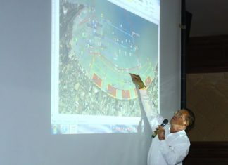Sanit Boonmachai, member of Pattaya City Council and president of the Pattaya Tourist Boat Club points out some of the details of the new plan.