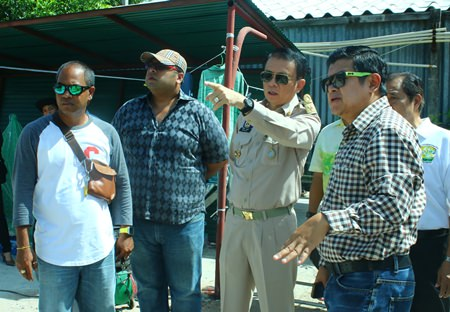 Banglamung District Chief Sakchai Taengho (2nd right) and Deputy Mayor Verawat Khakhay (right) inspect the progress of recovering the South Pattaya canal.