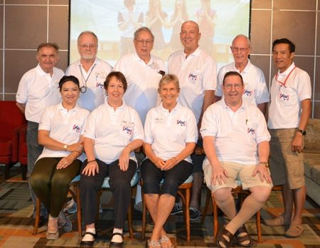 Members of the Board and others show off the club Polo shirt, featuring the new club logo.