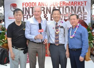 Dr. Iain Corness (2nd left) interviews for PMTV (L to R) Chairman Frank Lim, MD Edwin Lim, and Somsak Teerapattanakul, CEO of Foodland Co., Ltd.