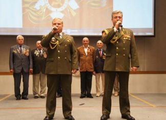 Russians sing their national anthem to celebrate the 69th anniversary of Victory Day.